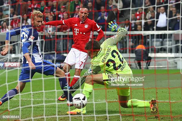 Franck Ribery of Muenchen scores the opening goal against Peter Pekarik of Berlin and his keeper Rune Jarstein during the Bundesliga match between...