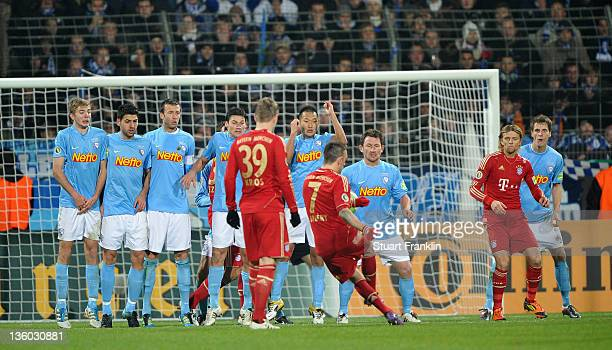 Franck Ribery of Muenchen takes a free kick against a wall of players of Bochum during the DFB Cup round of sixteen match between VfL Bochum and FC...