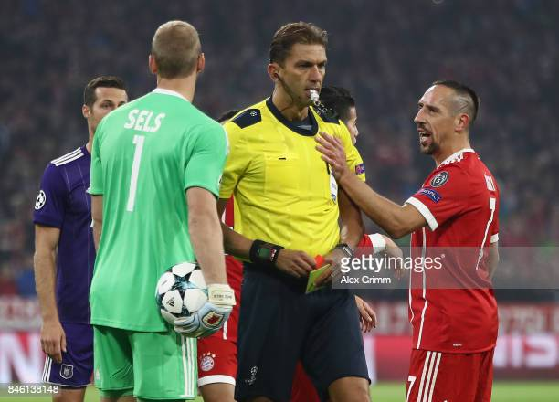 Franck Ribery of Muenchen touches referee Paolo Tagliavento after a yellow card during the UEFA Champions League group B match between Bayern...