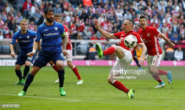 Franck Ribery of Munich and Aytac Sulu of Darmstadt vie for the ball during the Bundesliga first division soccer match between Bayern Munich and SV...