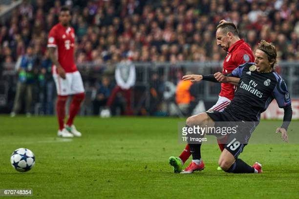 Franck Ribery of Munich and Luka Modric of Real Madrid battle for the ball during the UEFA Champions League Quarter Final first leg match between FC...