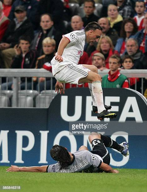 Franck Ribery of Munich jumps over Nicola Legrottaglie