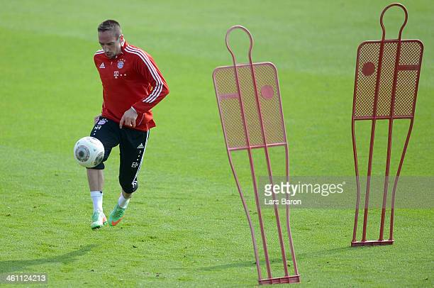 Franck Ribery runs with the ball during a training session at day 3 of the Bayern Muenchen training camp at ASPIRE Academy for Sports Excellence on...
