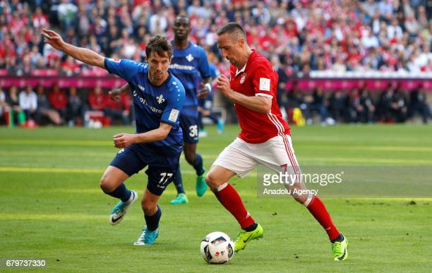 Franck Riberyi of Munich and Sandro Sirigu of Darmstadt vie for the ball during the Bundesliga first division soccer match between Bayern Munich and...