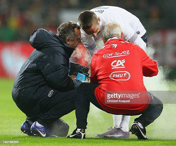 Franck Riberyof Franceis treated by a dcotor during the International friendly match between Germany and France at Weser Stadium on February 29 2012...
