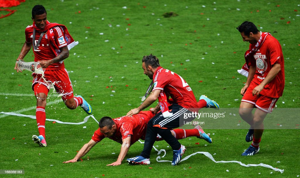 Franck Ribéry of Bayern Muenchen lies on the floor after being showered with beer following his team's match against Augsburg at the Allianz Arena on May 11, 2013 in Munich, Germany.