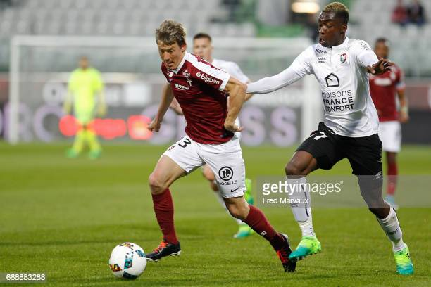Franck Signorino of Metz and Yann Karamoh of Caen during the Ligue 1 match between Fc Metz and SM Caen at Stade SaintSymphorien on April 15 2017 in...