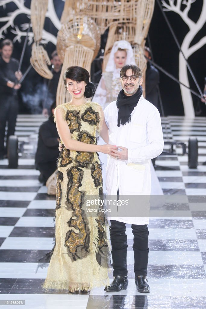 <a gi-track='captionPersonalityLinkClicked' href=/galleries/search?phrase=Franck+Sorbier+-+Fashion+Designer&family=editorial&specificpeople=13874944 ng-click='$event.stopPropagation()'>Franck Sorbier</a> (R) walks the runway during <a gi-track='captionPersonalityLinkClicked' href=/galleries/search?phrase=Franck+Sorbier+-+Fashion+Designer&family=editorial&specificpeople=13874944 ng-click='$event.stopPropagation()'>Franck Sorbier</a> show as part of Paris Fashion Week Haute Couture Spring/Summer 2014 on January 22, 2014 in Paris, France.