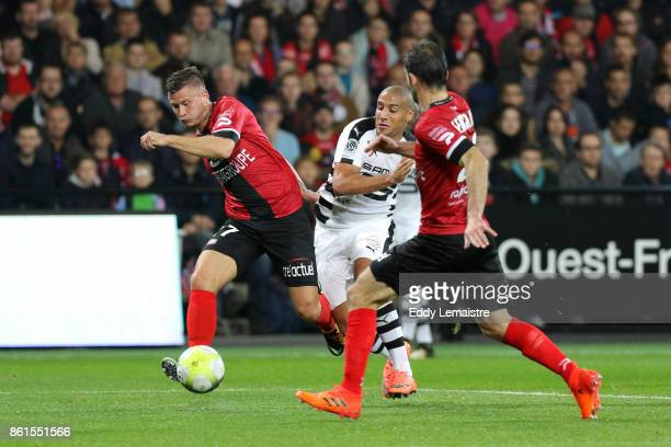 Franck Tabanou of Guingamp and Wahbi Khazri of Rennes during the Ligue 1 match between EA Guingamp and Stade Rennais at Stade du Roudourou on October...