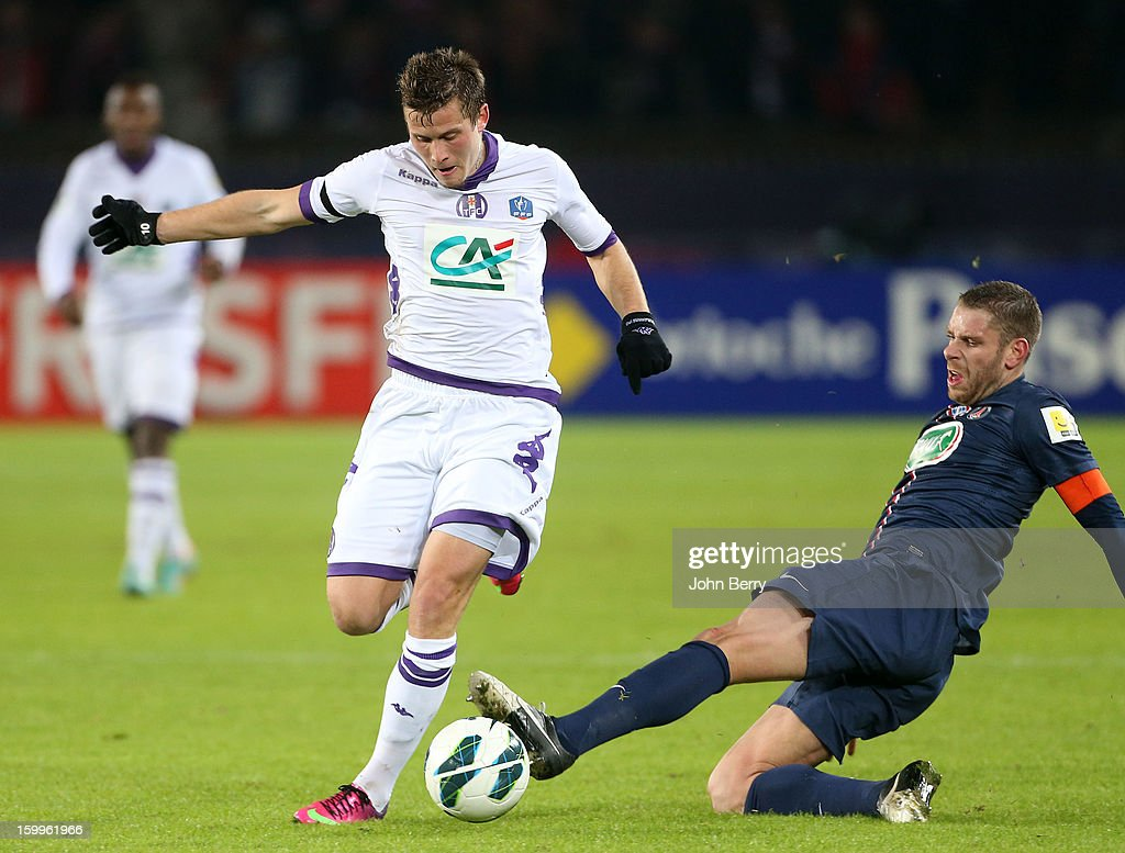 Franck Tabanou of TFC and Sylvain Armand of PSG in action during the French Cup match between Paris Saint Germain FC and Toulouse FC at the Parc des Princes stadium on January 23, 2013 in Paris, France.
