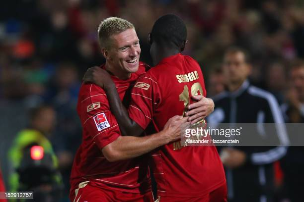Francky Sembolo of Regensburgcelebrates scoring the 3rd team goal with his team mate Christian Rahn during the Second Bundesliga match between Jahn...