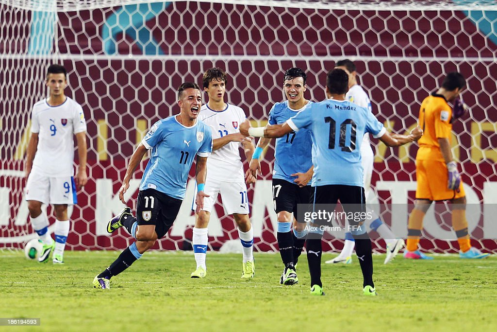 Franco Acosta #11 of Uruguay celebrates his team's third goal during the FIFA U-17 World Cup UAE 2013 Round of 16 match between Uruguay and Slovakia at Ras Al Khaimah Stadium on October 29, 2013 in Ras al Khaimah, United Arab Emirates.