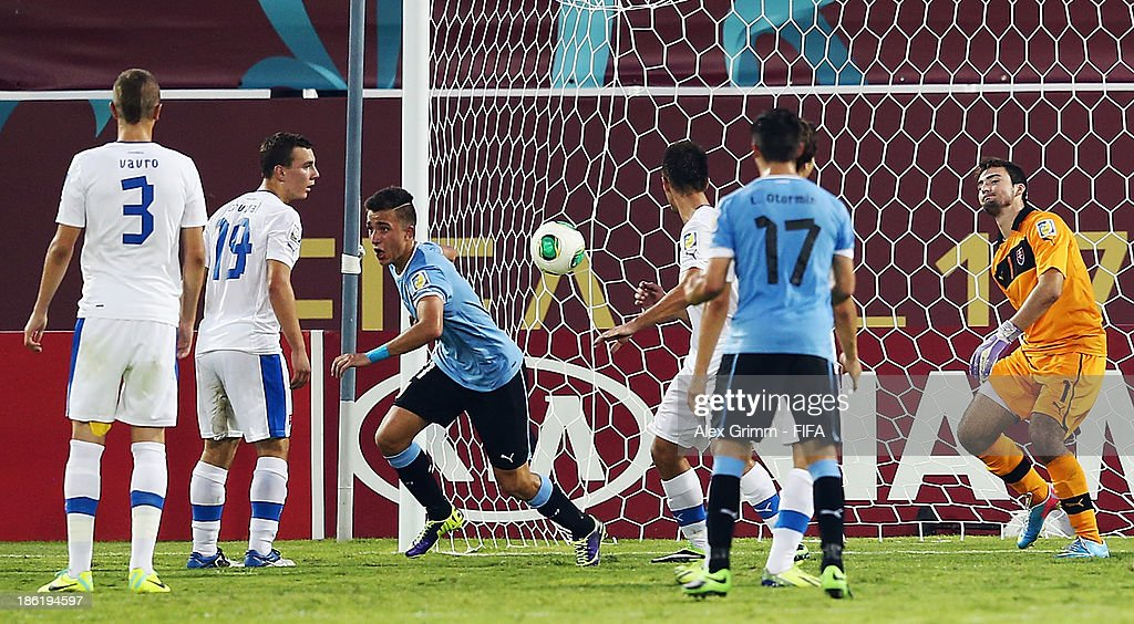Franco Acosta (3L) of Uruguay celebrates his team's third goal during the FIFA U-17 World Cup UAE 2013 Round of 16 match between Uruguay and Slovakia at Ras Al Khaimah Stadium on October 29, 2013 in Ras al Khaimah, United Arab Emirates.