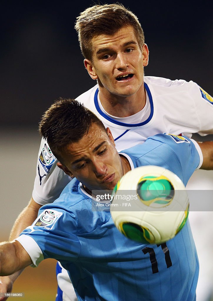 Franco Acosta (front) of Uruguay is challenged by Michal Vodecky of Slovakia during the FIFA U-17 World Cup UAE 2013 Round of 16 match between Uruguay and Slovakia at Ras Al Khaimah Stadium on October 29, 2013 in Ras al Khaimah, United Arab Emirates.