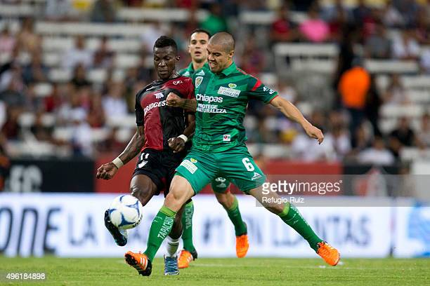 Franco Arizala of Atlas fights for the ball with Francisco Silva of Chiapas during the 16th round match between Atlas and Chiapas as part of the...