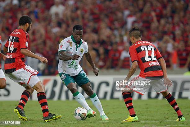 Franco Arizala of Leon fights for the ball with Wallace and Everton of Flamengo during a match between Flamengo and Leon as part of Copa Bridgestone...