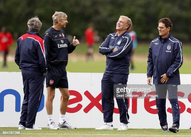 Franco Baldini Arsene Wenger Trevor Brooking and Fabio Capello during the training session at London Colney London