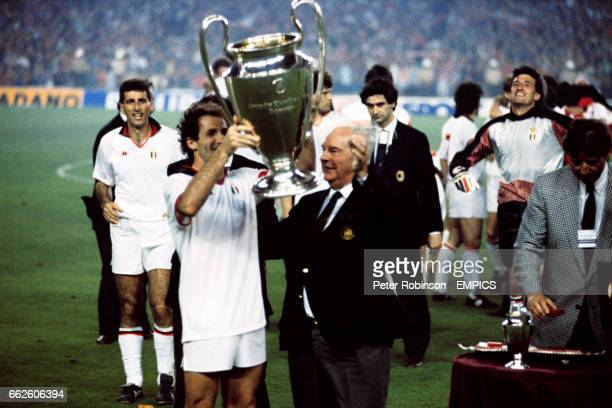 Franco Baresi lifts the European Cup with team mate Mauro Tassotti and goalkeeper Giovanni Galli joining him to celebrate