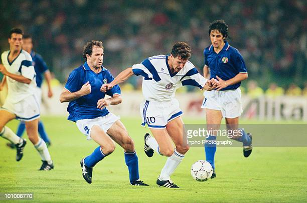 Franco Baresi of Italy challenges Peter Vermes of the United States of America during their Group A match of the 1990 FIFA World Cup on 14 June 1990...