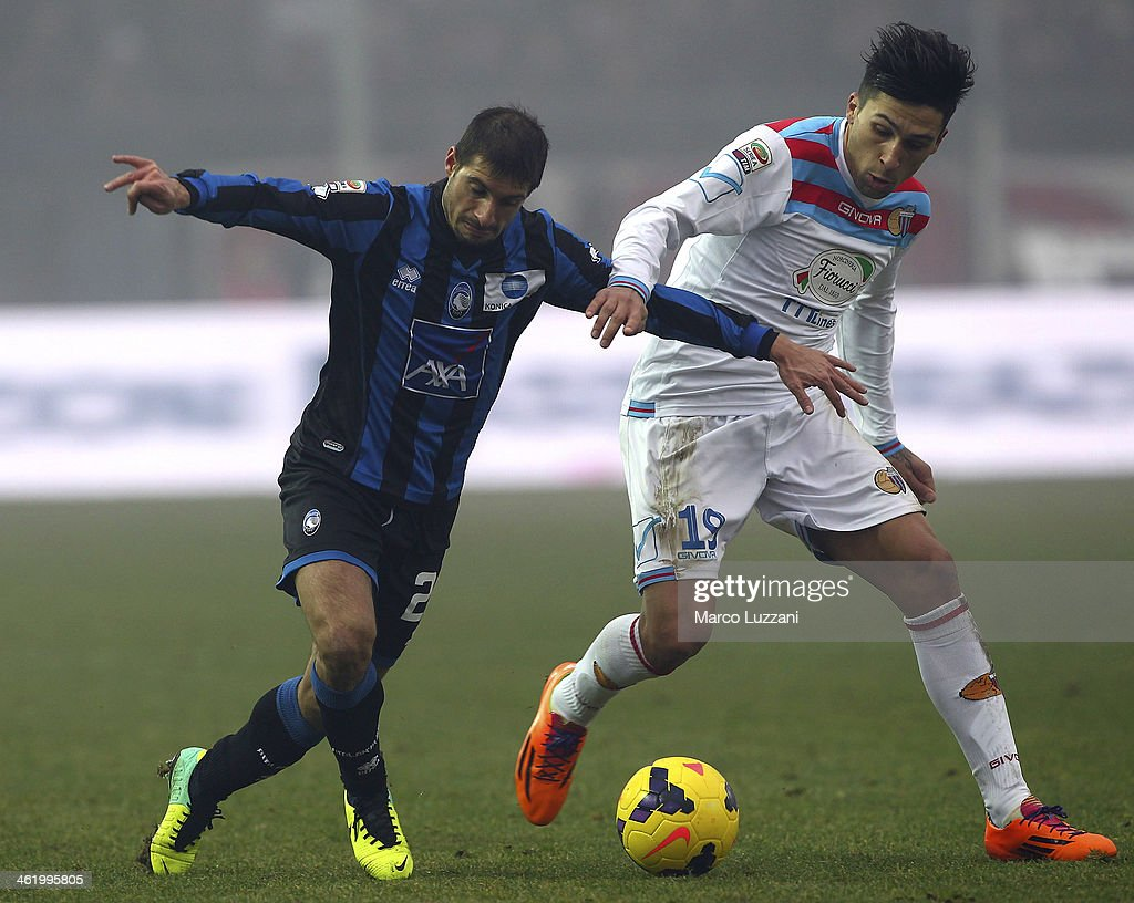 Franco Brienza of Atalanta BC competes for the ball with Lucas Nahuel Castro of Calcio Catania during the Serie A match between Atalanta BC and...