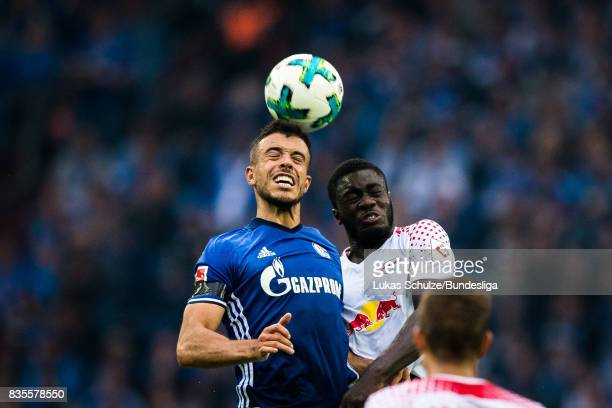 Franco Di Santo and Dayot Upamecano of Leipzig head the ball during the Bundesliga match between FC Schalke 04 and RB Leipzig at VeltinsArena on...