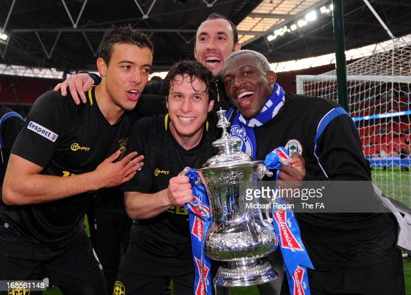 Franco Di Santo Ivan Ramis Arouna Kone of Wigan Athletic and team mate celebrate with the trophy after the FA Cup with Budweiser Final match between...