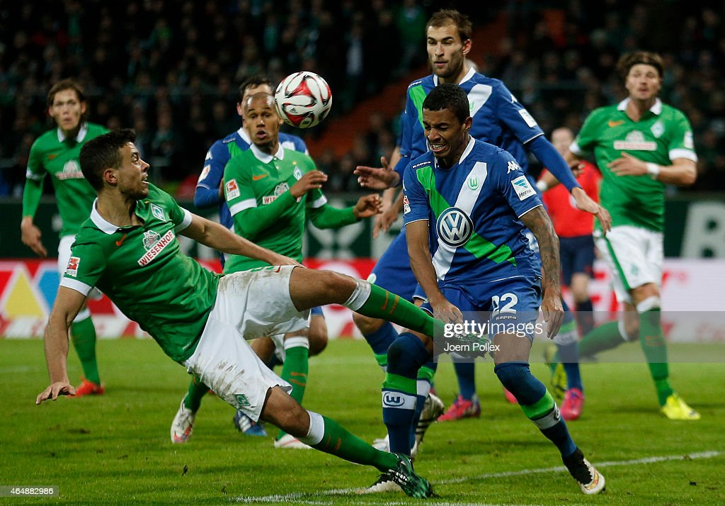 Franco Di Santo of Bremen and Luiz Gustavo of Wolfsburg compete for the ball during the Bundesliga match between SV Werder Bremen and VfL Wolfsburg...