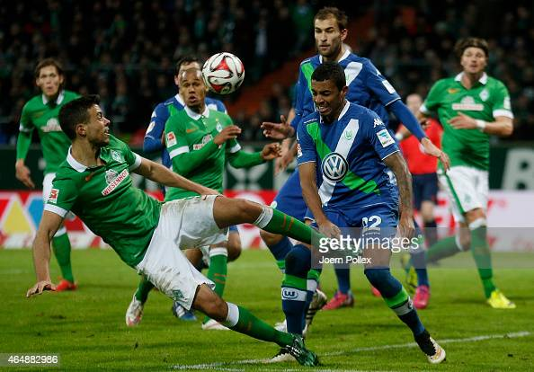 Franco Di Santo of Bremen and Luiz Gustavo of Wolfsburg compete for the ball during the Bundesliga match between SV Werder Bremen and VfL Wolfsburg...
