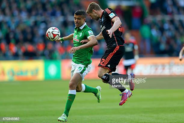 Franco Di Santo of Bremen and Matthias Ostrzolek of Hamburg battle for the ball during the Bundesliga match between SV Werder Bremen and Hamburger SV...