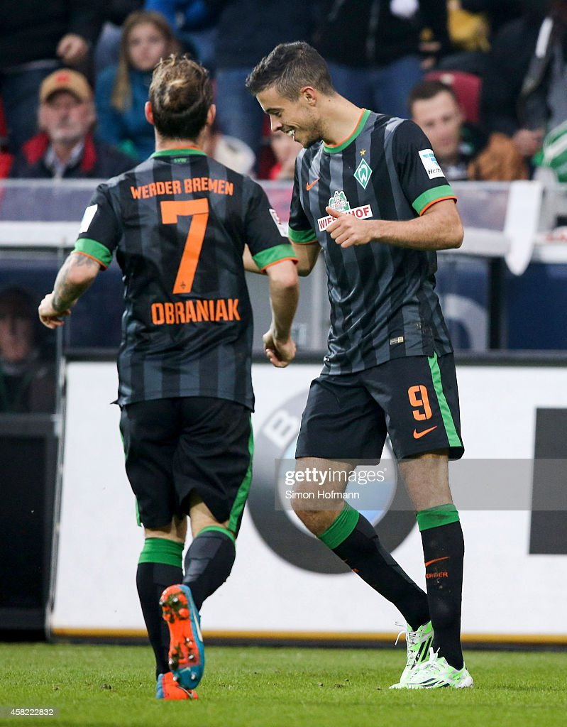 Franco di Santo of Bremen celebrates his team's second goal with his team mate <a gi-track='captionPersonalityLinkClicked' href=/galleries/search?phrase=Ludovic+Obraniak&family=editorial&specificpeople=661174 ng-click='$event.stopPropagation()'>Ludovic Obraniak</a> (L) during the Bundesliga match between 1. FSV Mainz 05 and SV Werder Bremen at Coface Arena on November 1, 2014 in Mainz, Germany.