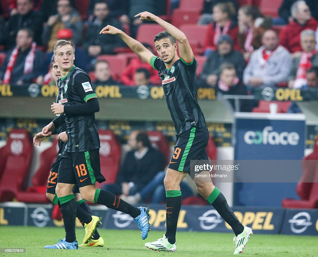 Franco di Santo of Bremen celebrates his team's second goal with his team mate <a gi-track='captionPersonalityLinkClicked' href=/galleries/search?phrase=Felix+Kroos&family=editorial&specificpeople=3522221 ng-click='$event.stopPropagation()'>Felix Kroos</a> (L) during the Bundesliga match between 1. FSV Mainz 05 and SV Werder Bremen at Coface Arena on November 1, 2014 in Mainz, Germany.