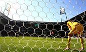 Franco di Santo of Bremen scores his team winning goal by penalty kick over Rene Adler goalkeeper of Hamburg during the Bundesliga match between SV...