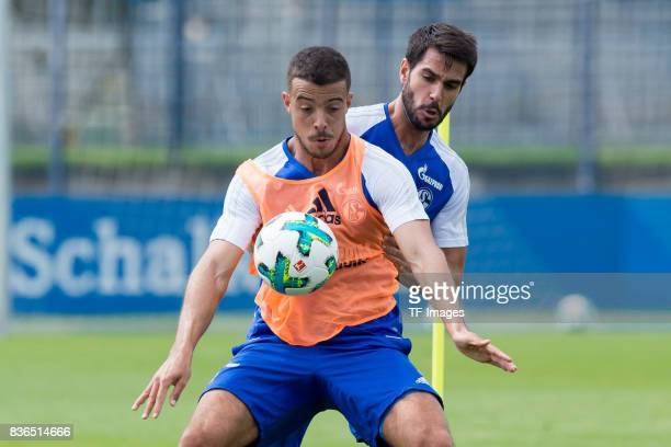 Franco Di Santo of Schalke and Pablo Insua of Schalke battle for the ball during a training session at the FC Schalke 04 Training center on July 5...