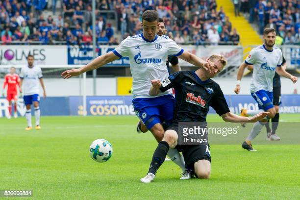 Franco Di Santo of Schalke and Thomas Bertels of Paderborn battle for the ball during the preseason friendly match between SC Paderborn and FC...
