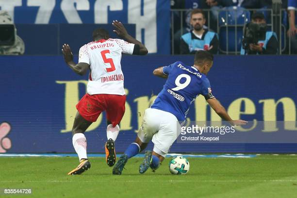 Franco Di Santo of Schalke is being fault by Dayot Upamecano of Leipzig which results in a penalty for Schalke during the Bundesliga match between FC...