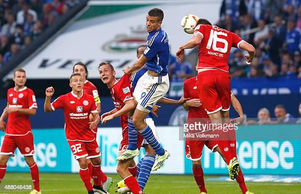 Franco di Santo of Schalke jumps for a header against Jhon Cordoba of Mainz during the Bundesliga match between FC Schalke 04 and 1 FSV Mainz 05 at...