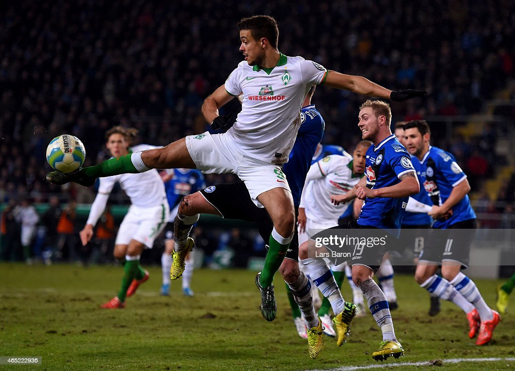 <a gi-track='captionPersonalityLinkClicked' href=/galleries/search?phrase=Franco+Di+Santo&family=editorial&specificpeople=4099757 ng-click='$event.stopPropagation()'>Franco Di Santo</a> of Werder Bremen jumps for the ball during the round of 16 DFB Cup match between Arminia Bielefeld and Werder Bremen on March 4, 2015 in Bielefeld, Germany.