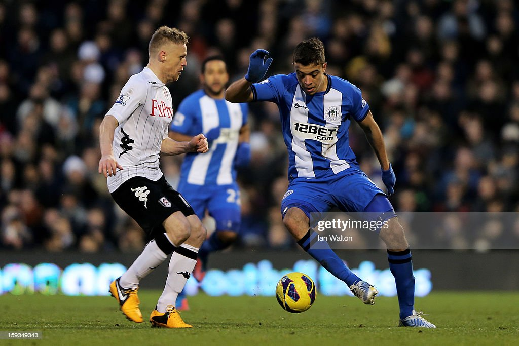 <a gi-track='captionPersonalityLinkClicked' href=/galleries/search?phrase=Franco+Di+Santo&family=editorial&specificpeople=4099757 ng-click='$event.stopPropagation()'>Franco Di Santo</a> of Wigan is challenged by <a gi-track='captionPersonalityLinkClicked' href=/galleries/search?phrase=Damien+Duff&family=editorial&specificpeople=171295 ng-click='$event.stopPropagation()'>Damien Duff</a> of Fulham during the Barclays Premier League match between Fulham and Wigan Athletic at Craven Cottage on January 12, 2013 in London, England.