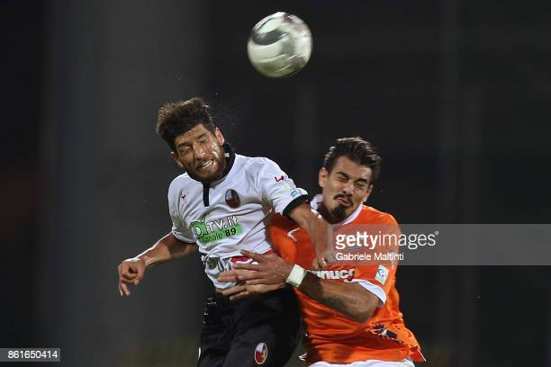 Franco Ferrari of US Pistoiese battles for the ball with Marcos Espeche of AS Lucchese Libertas during the Lega Pro match between US Pistoiese v AS...