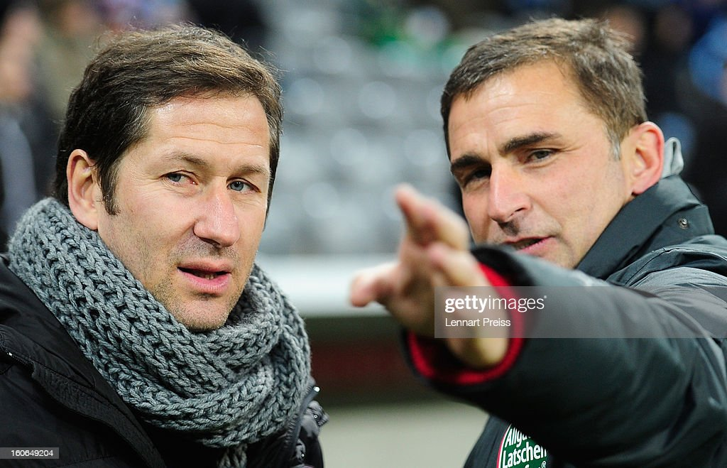 Franco Foda (L), head coach of Kaiserslautern an <a gi-track='captionPersonalityLinkClicked' href=/galleries/search?phrase=Stefan+Kuntz&family=editorial&specificpeople=535636 ng-click='$event.stopPropagation()'>Stefan Kuntz</a>, manager of Kaiserslautern talk to each other before the Second Bundesliga match between TSV 1860 Muenchen and 1. FC Kaiserslautern at Allianz Arena on February 4, 2013 in Munich, Germany.