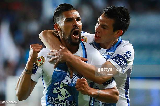 Franco Jara of Pachuca celebrates with teammate Hirving Lozano after scoring the second goal of his team during the 17th round match between Pachuca...