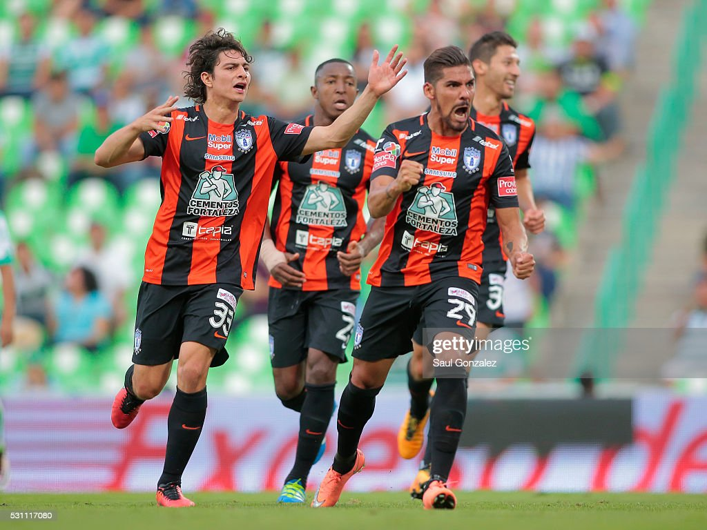 Franco Jara of Pachuca celebrates with teammates after scoring the first goal during the quarter finals first leg match between Santos Laguna and...
