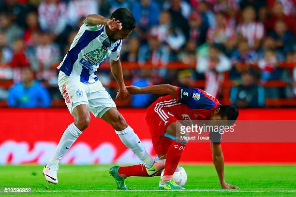 Franco Jara of Pachuca fights for the ball with Edwin Hernandez of Chivas during the 15th round match between Pachuca and Chivas as part of the...