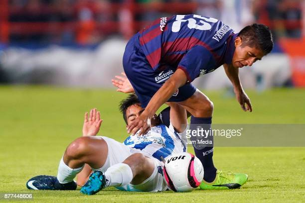 Franco Jara of Pachuca fights for the ball with Fernando Herrera of Atlante during the semifinal match between Pachuca and Atlante as part of the...