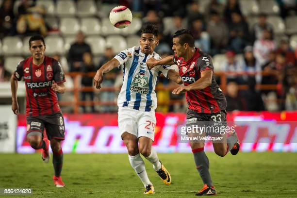 Franco Jara of Pachuca struggles for the ball with Mario de Luna of Necaxa during the 12th round match between Pachuca and Necaxa as part of the...