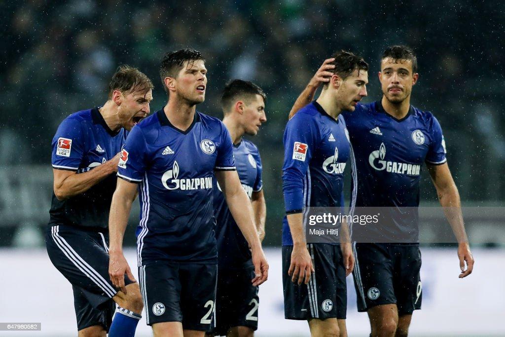 Franco Matias Di Santo (R), Leon Goretzka (2R) and Klaas-Jan Huntelaar (2L) of Schalke react after the Bundesliga match between Borussia Moenchengladbach and FC Schalke 04 at Borussia-Park on March 4, 2017 in Moenchengladbach, Germany.