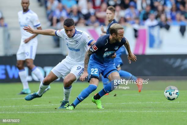 Franco Matias Di Santo of Schalke and Kevin Vogt of Hoffenheim battle for the ball during the Bundesliga match between TSG 1899 Hoffenheim and FC...