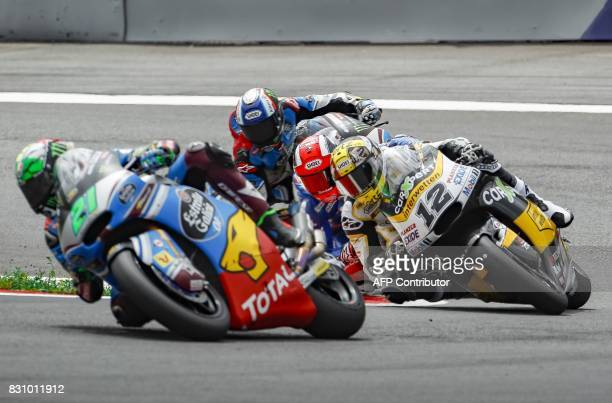 Franco Morbidelli of Italy Alex Marquez of Spain and Thomas Luthi of Switzerland compete during the Moto 2 race of the Austria Moto Grand Prix on...