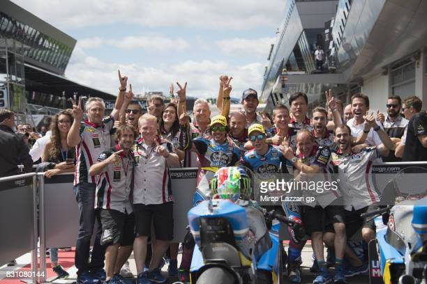 Franco Morbidelli of Italy and EG 00 Marc VDS and Alex Marquez of Spain and EG 00 Marc VDS celebrate with team under the podium at the end of the...