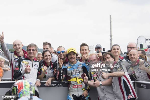Franco Morbidelli of Italy and EG 00 Marc VDS celebrates the victory with team under the podium at the end of the Moto2 race during the MotoGp of...